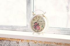 Vintage hours at a window Stock Images