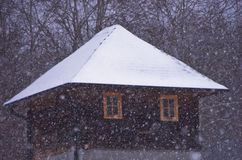 Vintage house with roof covered with snow during snow storm, mountain Kozomor Stock Images