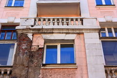 Vintage house with a sprinkle plaster. Old building and new Windows. Small columns. Stock Image