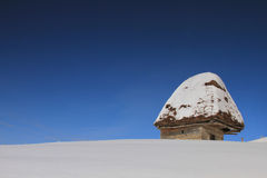An vintage house in a winter landscape. With blue sky royalty free stock images