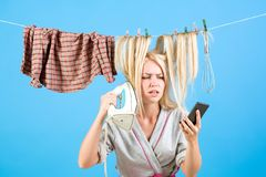 Vintage housekeeper woman. Multitasking mom. Performing Different Household Duties. Maid or housewife cares about house stock image