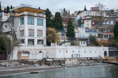 Vintage houses on a hill by the sea. In high quality Royalty Free Stock Images