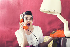 vintage housewife chats on the phone in Hair salon Royalty Free Stock Photography