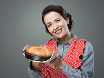 Vintage housewife holding an homemade cake Stock Photo