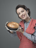 Vintage housewife holding an homemade cake Royalty Free Stock Photography