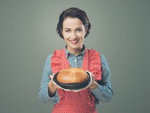 Vintage housewife holding an homemade cake Royalty Free Stock Images
