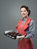 Vintage housewife with home made muffins Royalty Free Stock Image