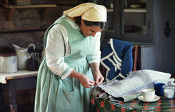 Vintage Housewife. One of the interpreters at Old World Wisconin, a living history museum, working on making a rug for her vintage kitchen Stock Photos