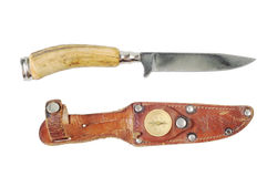 Vintage hunting knife with a bone. Handle and leather sheath. Isolated on white stock photo