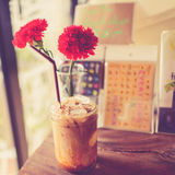 Vintage Ice coffee cup on grunge wooden table, Royalty Free Stock Images