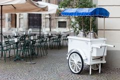 Vintage ice cream cart. Close up of an old cart-cream white Royalty Free Stock Photo