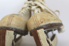 Vintage ice skates. Close up of pair of leather vintage women's ice skates with blade covers Royalty Free Stock Photo