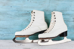 Vintage ice skates for figure skating on turquoise background. Vintage ice skates for figure skating on blue background royalty free stock photo
