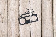 Music playing sign and symbol. Tape recorder with notes on wooden background. Delivery service. Bar, care, night club. Vintage icon with record player, tape stock photo