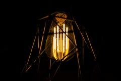 Vintage iluminado no fundo escuro Fotografia de Stock Royalty Free
