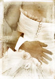 Vintage image of bridal couple on textured background Stock Image
