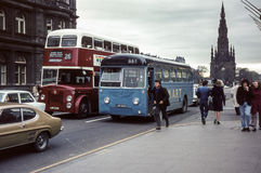 Vintage image of buses in Edinburgh. Edinburgh, UK - 1973: Vintage image of buses in traffic on Princes Street in Edinburgh.  Scottish Omnibus monocoach run by Royalty Free Stock Images