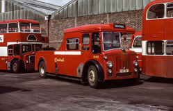 Vintage image of buses and towtruck. Scotland, UK - 1973: Vintage image of bus.  Central SMT tow truck S40registration number 193 GM parked outside bus garage Stock Photography