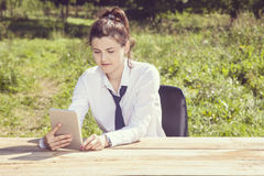 Vintage image of a businesswoman who uses a mobile device Stock Image