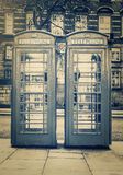 Vintage image of the famous phone booths in London Royalty Free Stock Photo