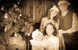 Vintage image of happy family with  Christmas tree Royalty Free Stock Image