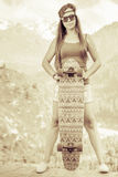 Vintage image of hippie young and beautiful girl with skateboard Stock Images