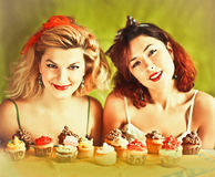 Vintage image: housewives and cupcakes. Vintage image with two housewives and cupcakes on the green background Stock Images
