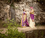 Vintage image of mature couple dressed in Balinese costume Royalty Free Stock Photo