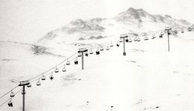 Vintage image of people in chairlift Stock Photo