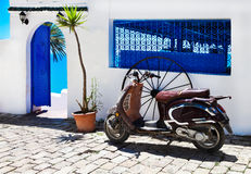 Vintage image of red scooter on the street Sidi Bou Said town Stock Images