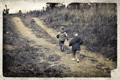 Vintage image with running children Royalty Free Stock Photography