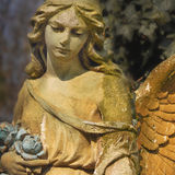 Vintage image of a sad angel on a cemetery against the backgroun Royalty Free Stock Images