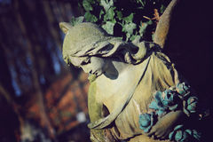 Vintage image of a sad angel on a cemetery Stock Photography