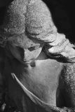 Vintage image of a sad angel on a cemetery against the black bac Stock Photography