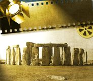 Vintage image of Stonehenge with reel, film strip and reflector. Useful in touristic context Royalty Free Stock Photo