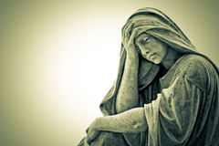 Vintage image of a suffering religious woman. Statue Stock Photo