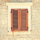 Vintage image with window and shutters Stock Photography