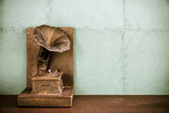 Vintage imitation turntable or gramophone on wall background. Stock Images
