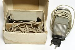 Vintage impulse camera flash unit in original cardboard box. Vintage camera flash unit in a box. old electronic impulse device for camera stock images