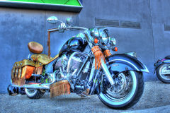 Vintage Indian motorcycle. Vintage American black Indian motorcycle with leather seat and saddlebags and leather tassels on display at car and bike show in royalty free stock image