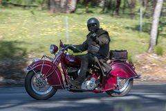 Vintage Indian Motorcycle on country road. Adelaide, Australia - September 25, 2016: Vintage Indian Motorcycle on country roads near the town of Birdwood, South Stock Images