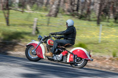 Vintage Indian Motorcycle on country road. Adelaide, Australia - September 25, 2016: Vintage Indian Motorcycle on country roads near the town of Birdwood, South Royalty Free Stock Photos
