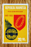 Vintage Indonesia postage stamp. A vintage unused Indonesia 1965 mint of State Principles postal stamps Royalty Free Stock Photography