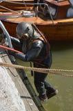 Vintage Industrial Diver. Sobmergence of vintage industrial diver in water stock photo