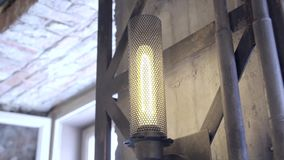 Vintage industrial lamp. Ceiling lamp decor home or shop bright in orange light. Beautiful antique retro vintage edison light bulbs garland in loft interior on stock footage