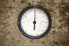 Vintage industrial meter on a metal background Royalty Free Stock Images