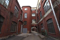 Vintage industrial red brick building in the industrial area of the old European city. Stock Photos