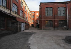 Vintage industrial red brick building in the industrial area of the old European city. Royalty Free Stock Photography