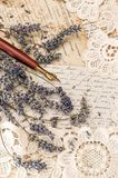 Vintage ink pen lavender flowers old love letters. Vintage ink pen, dried lavender flowers and old love letters Stock Photo