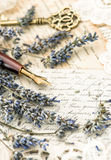 Vintage ink pen, key, lavender flowers and old love letters Stock Photos